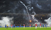 Play is stopped after fireworks are thrown onto the pitch by the Croatia fans during the EURO 2016 Group H Qualifier match between Italy and Croatia...
