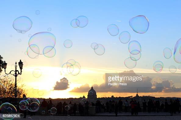 Play of colors and life in the light of the sunset with soap bubbles on the Pincio terrace