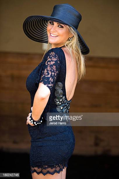 Playboy and TV personality Josie Goldberg roots for her horse 'Only Josie Knows' at Del Mar Thoroughbred Club on August 12 2012 in Del Mar California