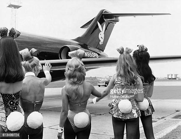 Playboy Bunnies wave as Hugh Hefner's private jet Big Bunny lands in London