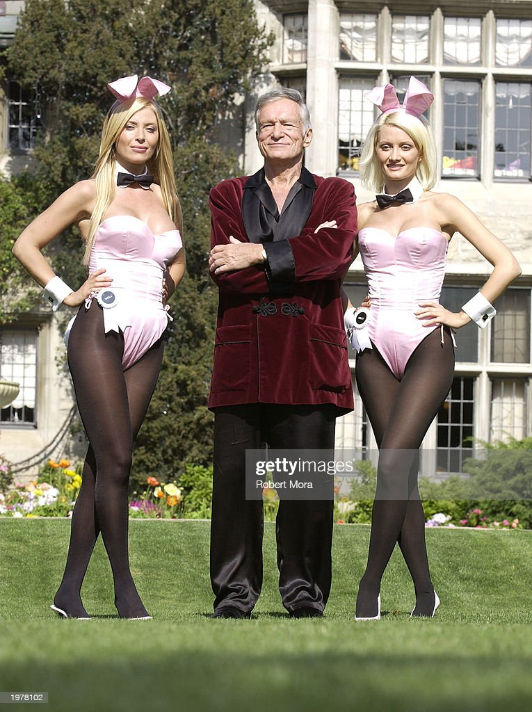 Playboy bunny Sheila Levell Playboy founder Hugh Hefner and Playboy bunny Holly Madison perform a scene during the filming of a commercial for 'X...