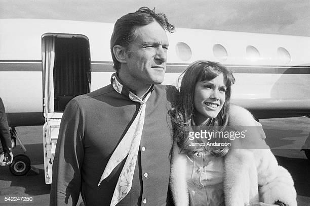Playboy CEO Hugh Hefner with partner model actress and singer Barbara Benton arrive at Paris Airport