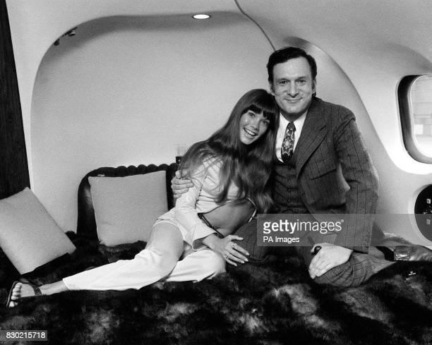 Playboy chief Hugh Hefner with model Barbara Benton aboard his private Douglas DC930 plane nicknamed The Big Bunny
