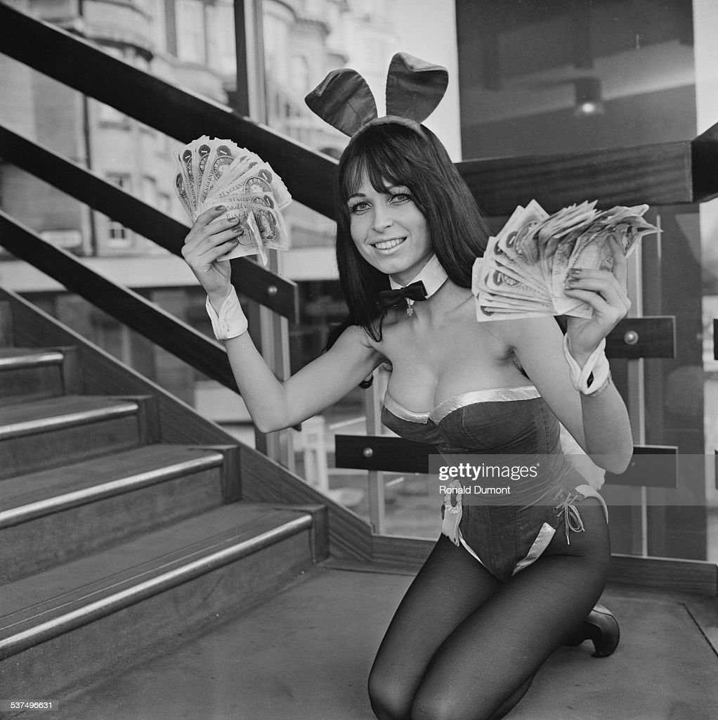Playboy Club Bunny Girl Christel posing with money after the Playboy Club announces a pay increase for women working at the club in the hope to...