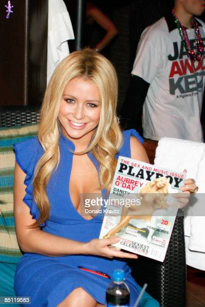 Playboy covergirl Aubrey O'Day holds up her cover issue of Playboy Magazine during her visit to the Pool at Harrahs on February 25 2009 in Atlantic...