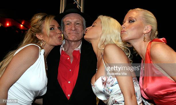 Playboy founder Hugh Hefner and his friends Bridget Marquardt Holly Madison and Kendra Wilkinson pose for a picture during a party to celebrate his...