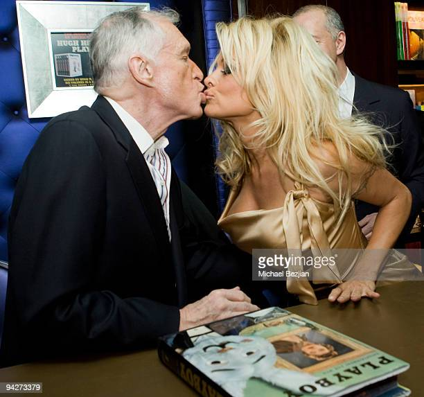 Playboy founder Hugh Hefner and model Pamela Anderson attend the Hugh Hefner Autographs Limited Edition SixVolume Anthology Party by Taschen on...