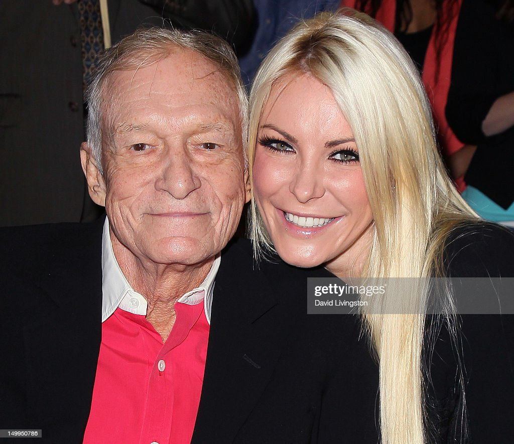Playboy founder Hugh Hefner (L) and TV personality Crystal Harris attend the Beverly Hills City Council and Playboy Enterprises, Inc.'s celebration of the return of Playboy headquarters to Beverly Hills on August 7, 2012 in Beverly Hills, California.