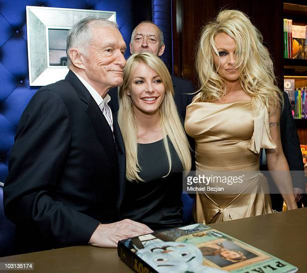 Playboy founder Hugh Hefner model Crystal Harris publisher Benedikt Taschen and model Pamela Anderson attend the Hugh Hefner Autographs Limited...