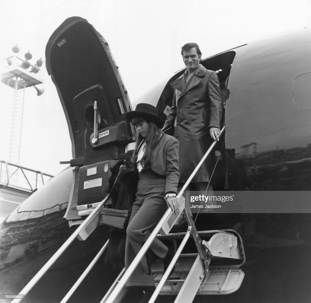 Playboy impresario Hugh Hefner (1926 - 2017) and his girlfriend, Barbi Benton, arriving at Gatwick Airport, 20th February 1971.