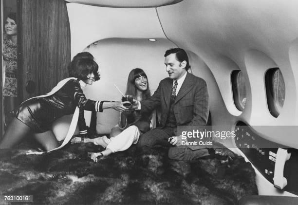 Playboy impresario Hugh Hefner and his girlfriend Barbi Benton on board Hefner's private DC9 airliner 'The Big Bunny' at London Airport 29th...