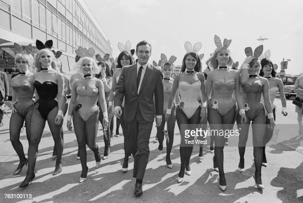 Playboy impresario Hugh Hefner with a group of bunny girls at London Airport 25th June 1966 Hefner has flown in for the opening of the London Playboy...