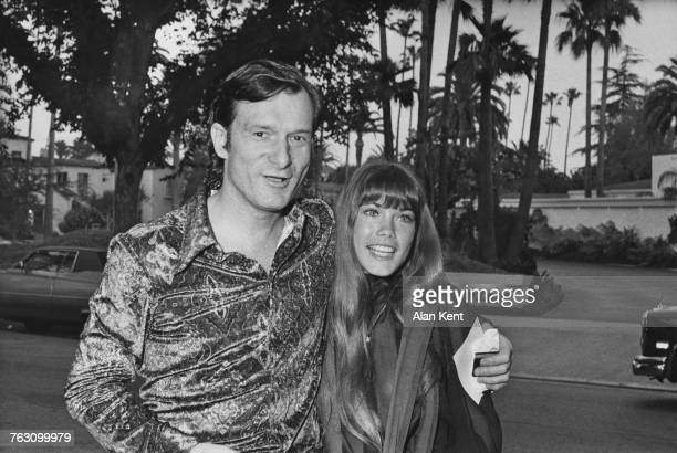 Playboy impresario Hugh Hefner with his girlfriend Barbi Benton arriving at a house party given by Polly Bergen and Freddie Fields Los Angeles...