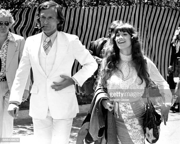 Playboy magazine founder Hugh Hefner and his girlfriend Barbi Benton are pictured at the Brandeis University commencement in Waltham MA on May 19 1974