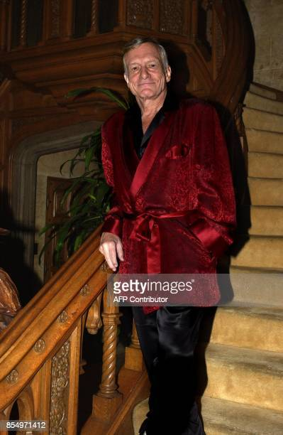 Playboy magazine founder Hugh Hefner poses at his Los Angeles California home Wednesday 19 November 2003 Fifty years after Hefner launched Playboy...