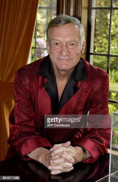 Playboy magazine founder Hugh Hefner poses at his Los Angeles California home 19 November 2003 Fifty years after Hefner launched Playboy and a sexual...