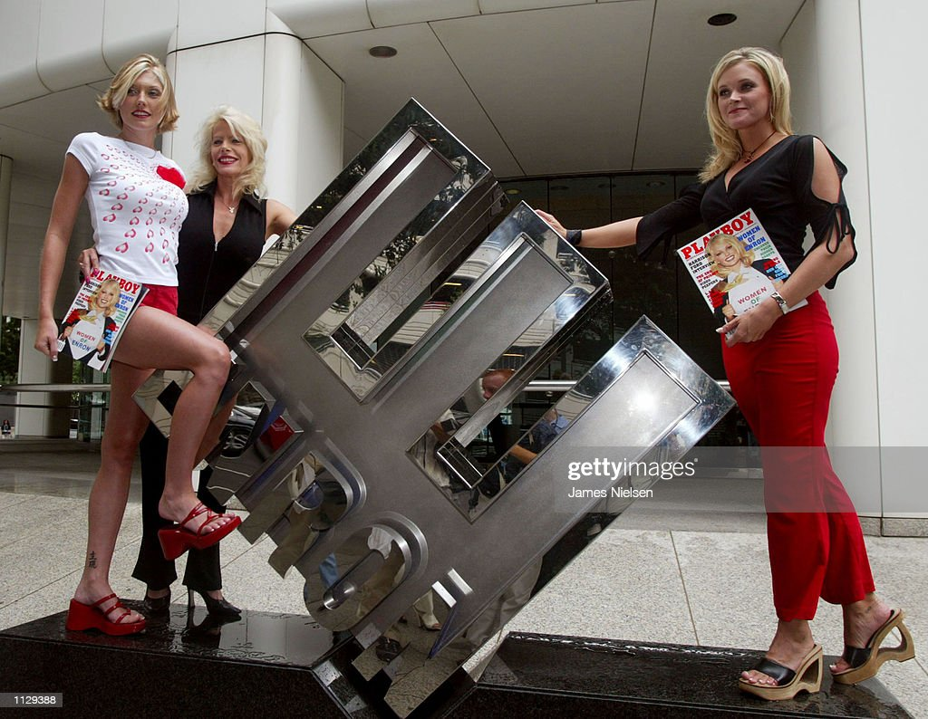 Playboy magazine's 'Women of Enron,' former Enron employees Shari Daugherty (L), Janine Howard (C), and Courtnie Parker pose for a photograph outside Enron's headquarters June 26, 2002 in Houston, Texas. The women were featured in the August issue of Playboy magazine.