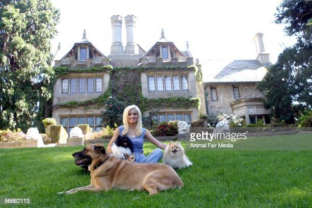 Playboy model Holly Madison poses for portraits with her pet dogs during a photo shoot at the Playboy Mansion in Los Angeles CA on November 10 2005