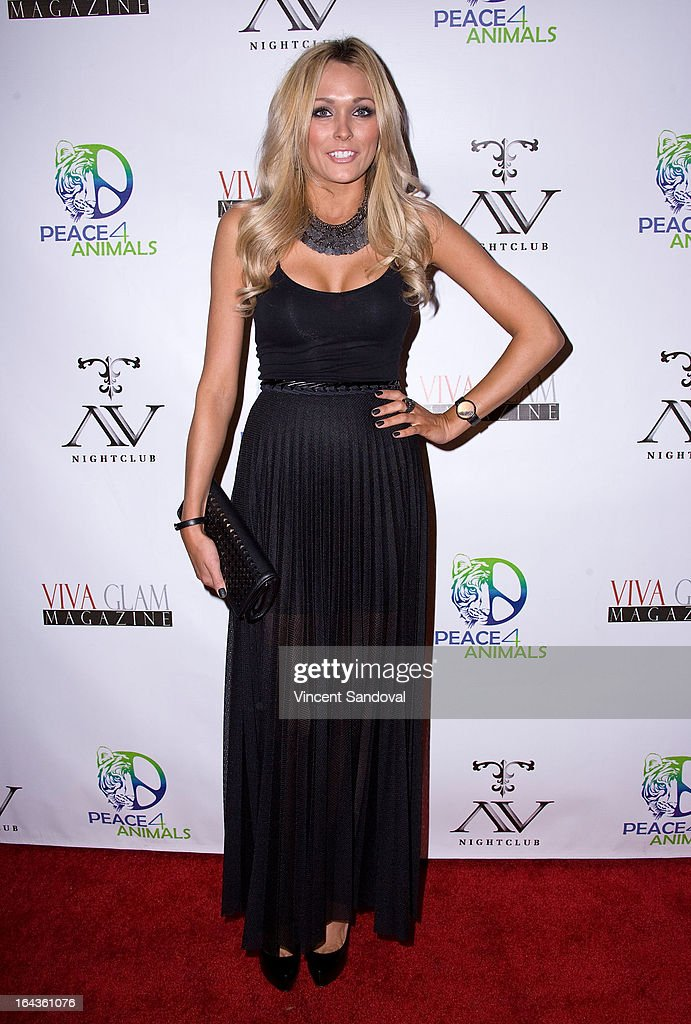 Playboy Playmate Holly Dorrough attends the Viva Glam Magazine April launch party in support of Peace 4 Animals at AV on March 22, 2013 in Hollywood, California.