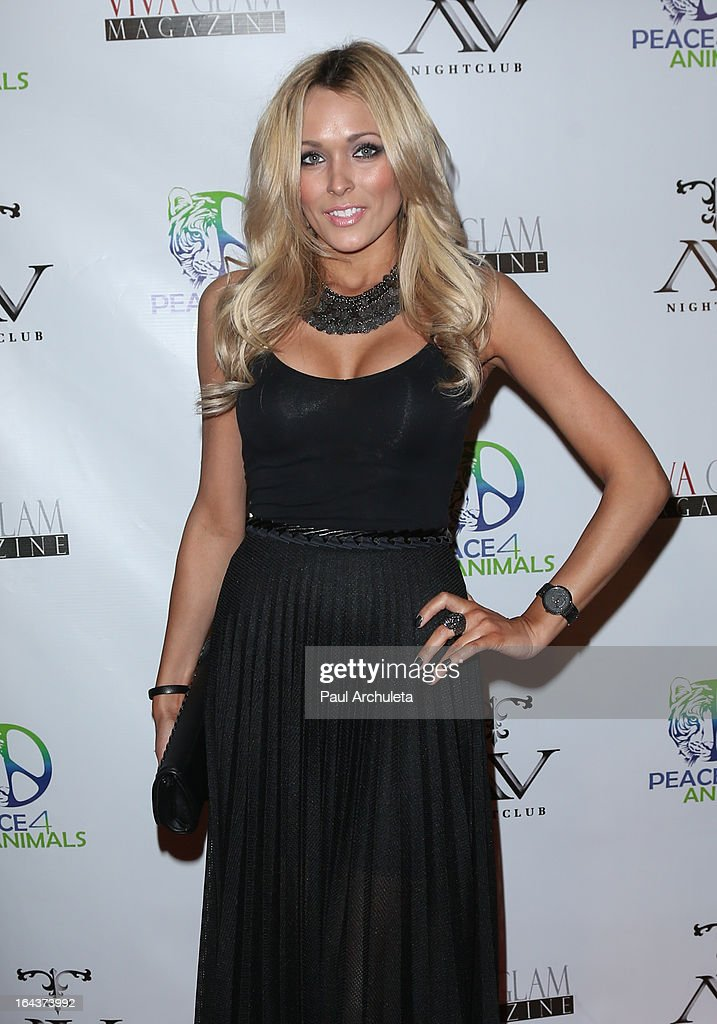 Playboy Playmate / Model Holley Dorrough attends the Viva Glam Magazine April launch party in support of Peace 4 Animals at AV Nightclub on March 22, 2013 in Hollywood, California.