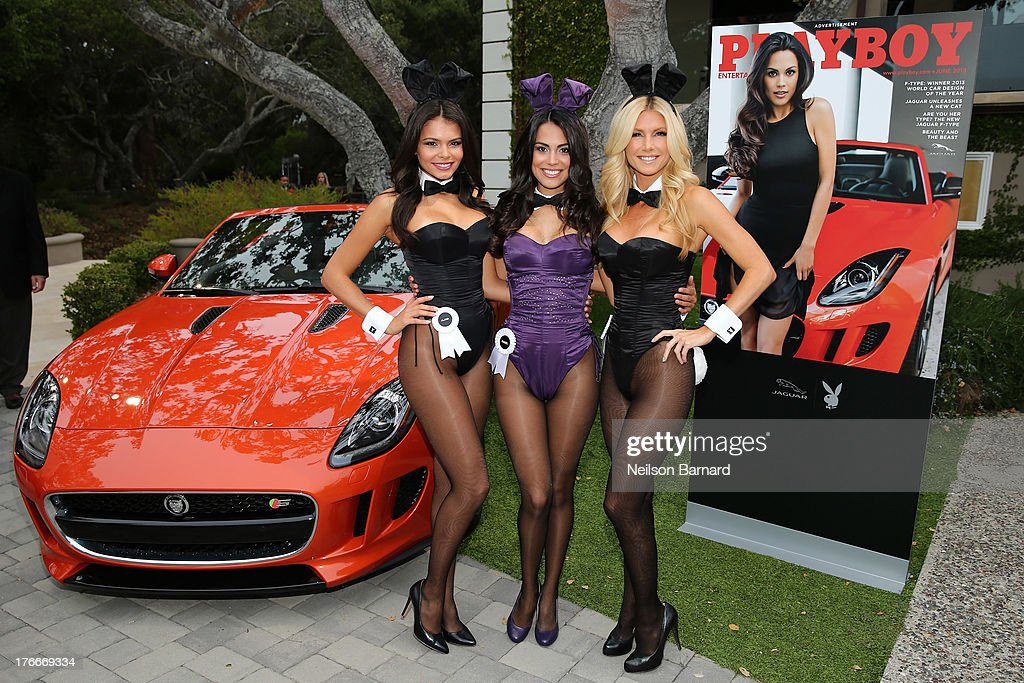 Playboy Playmate of the Year, <a gi-track='captionPersonalityLinkClicked' href=/galleries/search?phrase=Raquel+Pomplun&family=editorial&specificpeople=10120930 ng-click='$event.stopPropagation()'>Raquel Pomplun</a> (C) with the 2014 Jaguar F-TYPE at the Jaguar and Playboy Magazine exclusive VIP reception to celebrate Jaguar's high-performance models during Pebble Beach weekend on August 16, 2013 in Monterey, California.