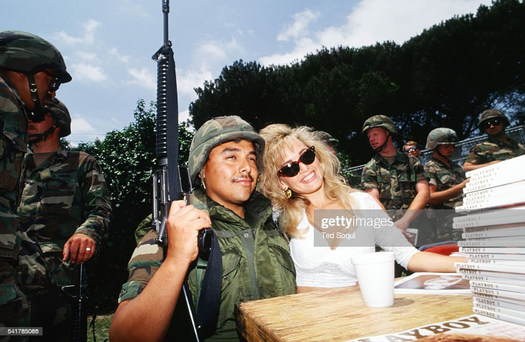 Playboy Playmate Suzi Simpson signs autographs for National Guard soldiers posted near the Coliseum in Los Angeles Los Angeles has undergone several...