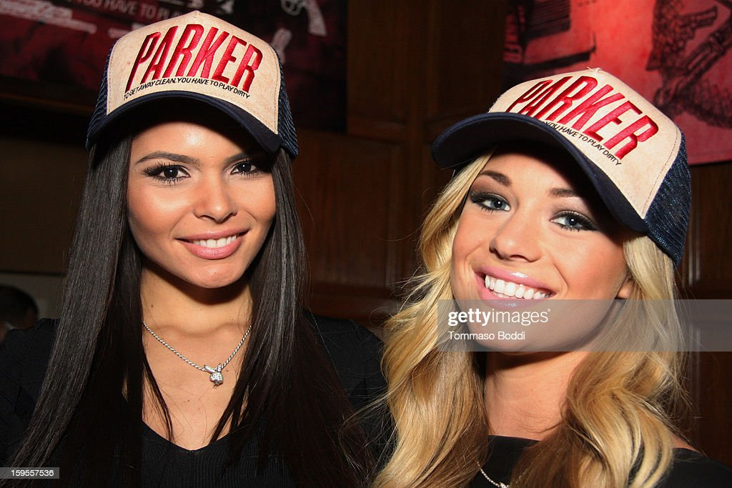 Playboy's Miss September 2012 Alana Campos (L) and Miss May 2012 Nikki Leigh attend the 'Parker' Playboy Mansion 'Art Of The Heist' street art gallery viewing and screening held at the The Playboy Mansion on January 15, 2013 in Beverly Hills, California.