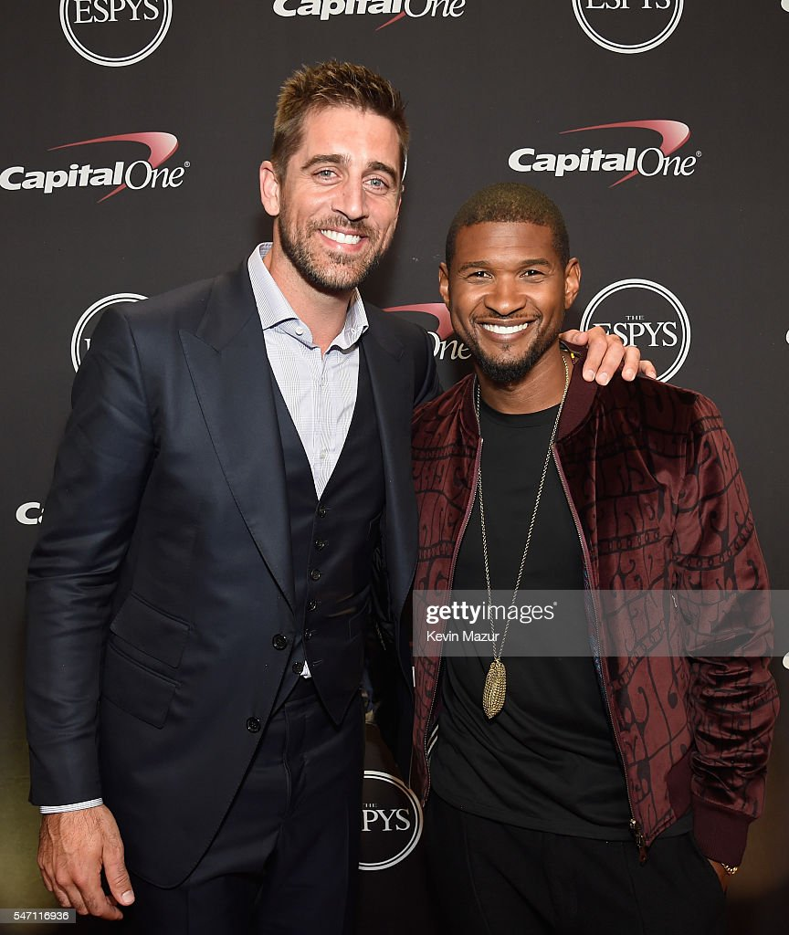 NFL player Aaron Rodgers and recording artist Usher attend the 2016 ESPYS at Microsoft Theater on July 13 2016 in Los Angeles California