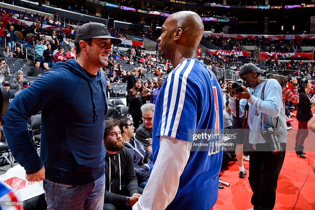 NFL player Aaron Rodgers speaks with Chauncey Billups #1 of the Los Angeles Clippers before a game between the Milwaukee Bucks and Clippers at Staples Center on March 6, 2013 in Los Angeles, California.