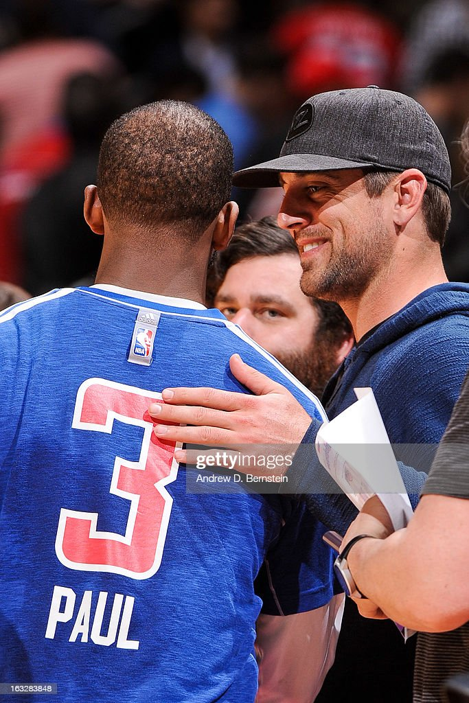 NFL player Aaron Rodgers speaks with Chris Paul #3 of the Los Angeles Clippers following a game between the Milwaukee Bucks and Clippers at Staples Center on March 6, 2013 in Los Angeles, California.