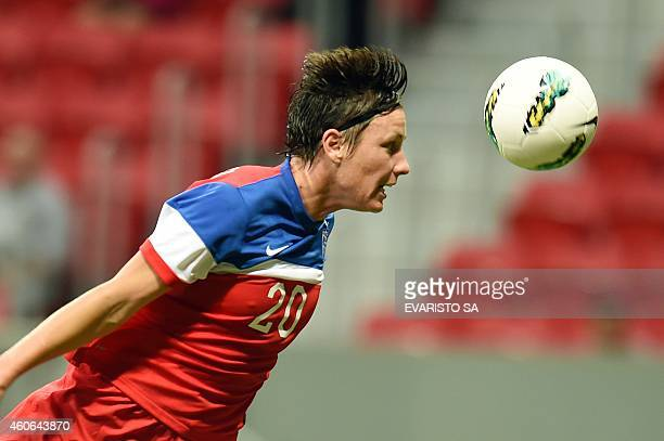 US player Abby Wambach heads the ball during their Brasilia International Tournament football match against Argentina at Mane Garrincha Stadium in...