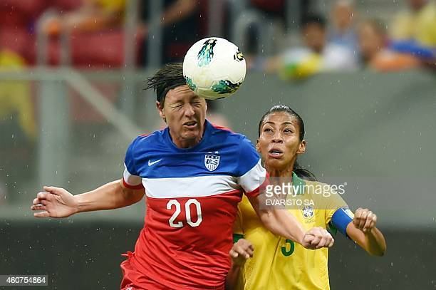US player Abby Wambach heads the ball next to Brazil's player Bruna Soares during their Brasilia International Tournament final football match at...