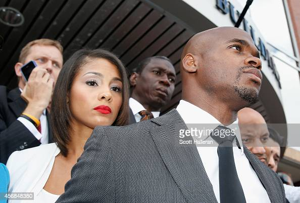 NFL player Adrian Peterson of the Minnesota Vikings waits with his wife Ashley Brown after making a court appearance at the Montgomery County...