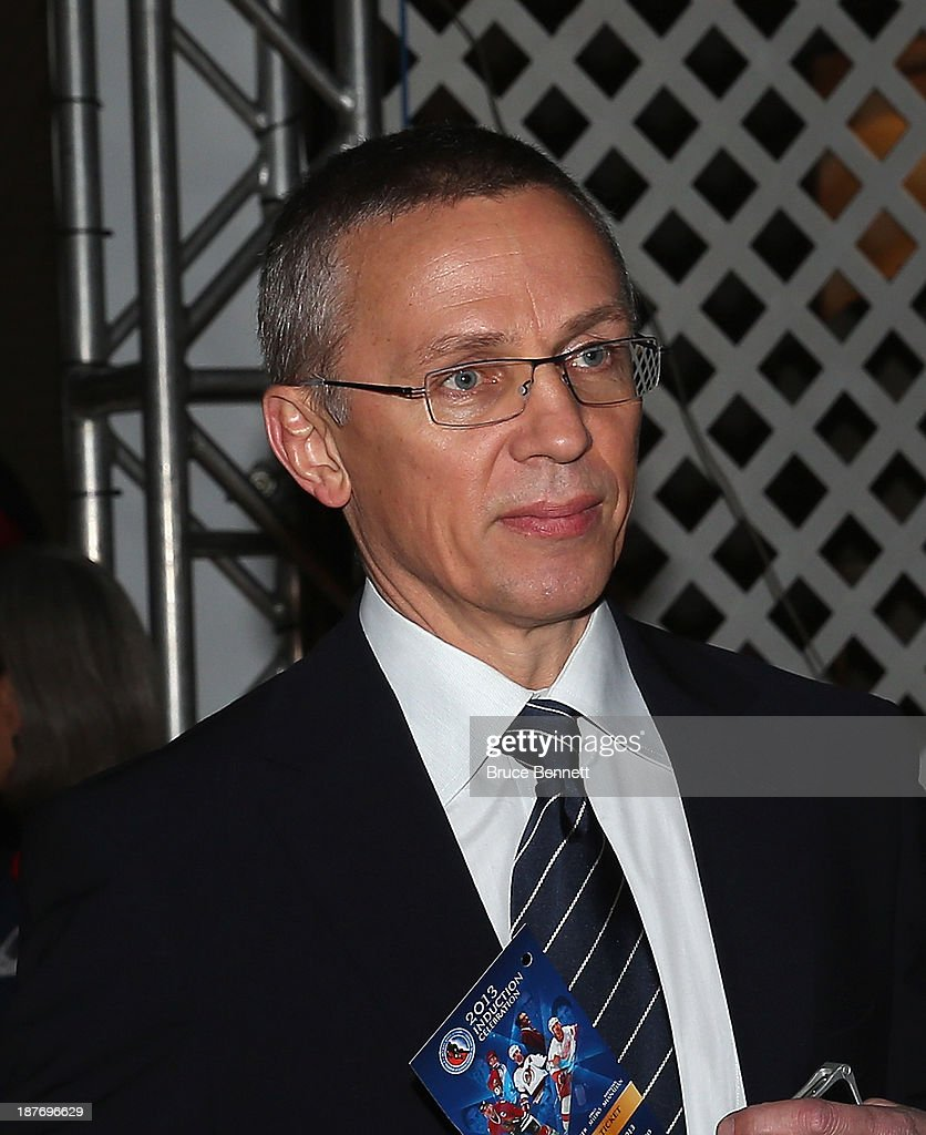 Player agent <a gi-track='captionPersonalityLinkClicked' href=/galleries/search?phrase=Igor+Larionov&family=editorial&specificpeople=201768 ng-click='$event.stopPropagation()'>Igor Larionov</a> walks the red carpet prior to the 2013 Hockey Hall of Fame induction ceremony on November 11, 2013 in Toronto, Canada.