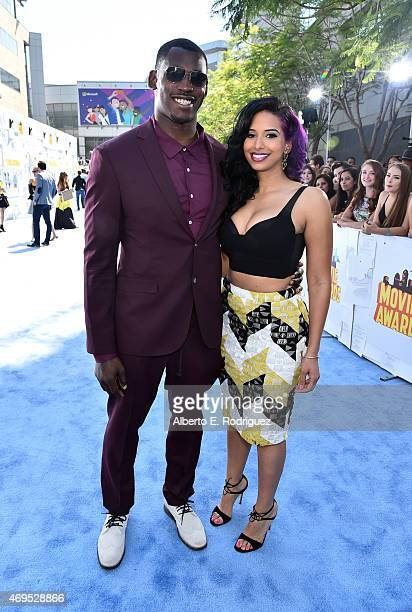 NFL player Aldon Smith and host Nessa attend The 2015 MTV Movie Awards at Nokia Theatre LA Live on April 12 2015 in Los Angeles California