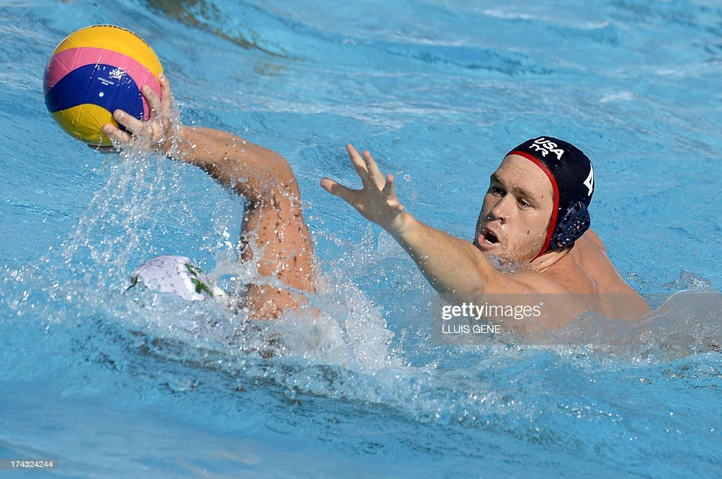 US player Alexander Bowen (R) vies with South Africa's Donn Stewart (L) during the preliminary round match of the men's water polo competition between the US and South Africa at the FINA World Championships at the Bernat Picornell swimming pool in Barcelona on July 24, 2013. AFP PHOTO/ LLUIS GENE