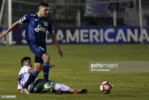 Player Alexis Ribera of Oriente Petrolero of Bolivia vies for the ball with David Barbona of Atletico Tucuman of Argentina during their Sudamericana...