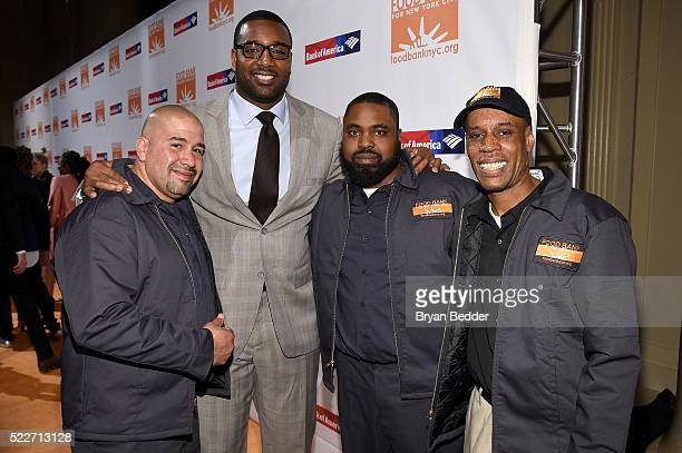 NFL player and Food Bank ambassador Chris Canty poses with Warehouse Professionals at the Food Bank Of New York City's Can Do Awards 2016 hosted by...