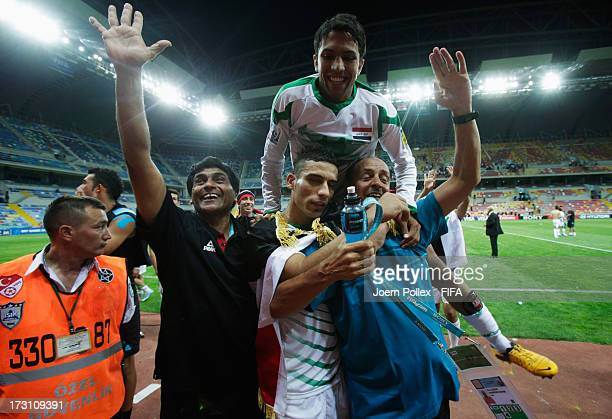 Player and head coach Hakeem Al Azzawi of Iraq celebrate after he saved a penalty during the FIFA U20 World Cup Quarter Final match between Iraq and...