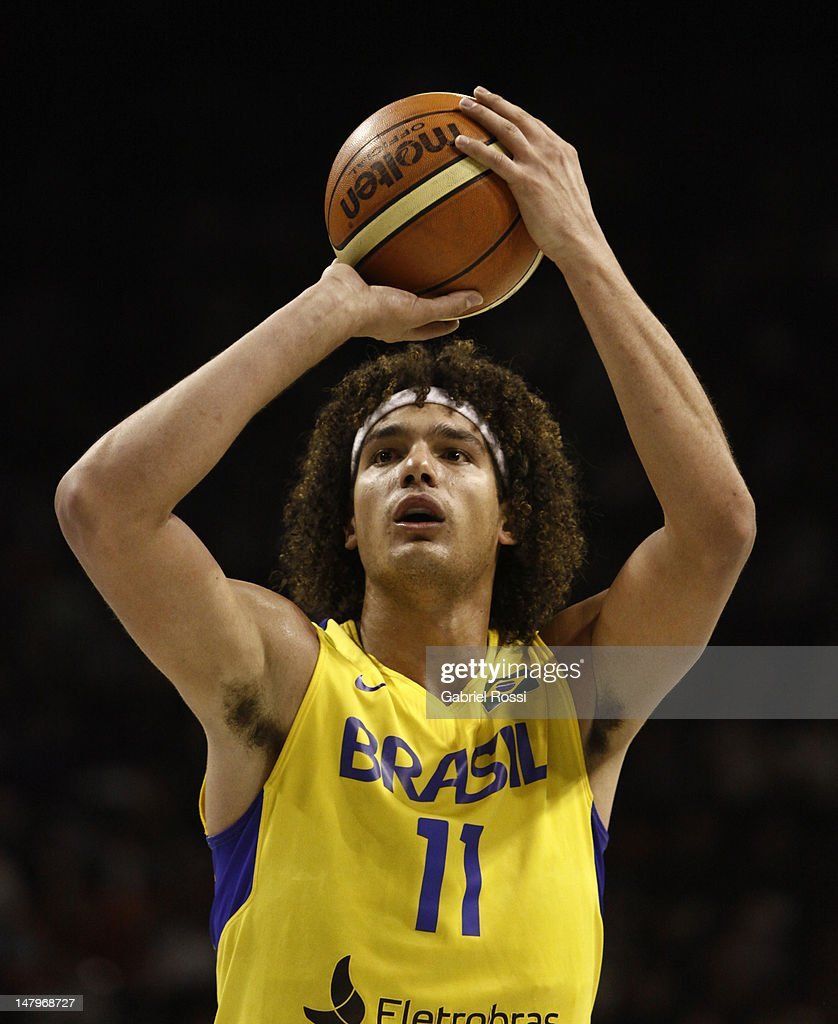 Player <a gi-track='captionPersonalityLinkClicked' href=/galleries/search?phrase=Anderson+Varejao&family=editorial&specificpeople=202247 ng-click='$event.stopPropagation()'>Anderson Varejao</a>, from Brazil, looks to shoot during a basketball match between Argentina and Brazil as part of the Hope Funds Cup at Luna Park Stadium on July 06, 2012 in Buenos Aires, Argentina.