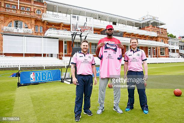 NBA player Andre Drummond holds a Middlesex shirt as he poses for the camera with Middlesex Cricketers Eoin Morgan of England and Brendan McCullum of...