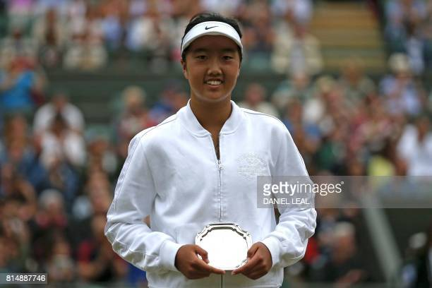 US player Ann Li poses with her runnersup trophy after losing against US player Claire Liu in their girl's singles final match on the twelfth day of...