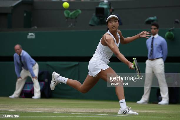 US player Ann Li returns against US player Claire Liu during their girl's singles final match on the twelfth day of the 2017 Wimbledon Championships...