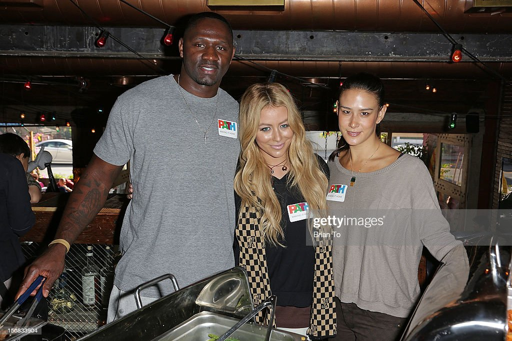 NFL player <a gi-track='captionPersonalityLinkClicked' href=/galleries/search?phrase=Anthony+Henry&family=editorial&specificpeople=242880 ng-click='$event.stopPropagation()'>Anthony Henry</a>, <a gi-track='captionPersonalityLinkClicked' href=/galleries/search?phrase=Aubrey+O%27Day&family=editorial&specificpeople=570062 ng-click='$event.stopPropagation()'>Aubrey O'Day</a>, and Ericka Hunter attend PATH's 4th Annual Thanksgiving Meal at Pink Taco on November 22, 2012 in Los Angeles, California.