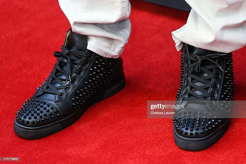 NFL player <a gi-track='captionPersonalityLinkClicked' href=/galleries/search?phrase=Antonio+Cromartie&family=editorial&specificpeople=583197 ng-click='$event.stopPropagation()'>Antonio Cromartie</a> (shoe detail) arrives at the 'Kevin Hart: Let Me Explain' premiere at Regal Cinemas L.A. Live on June 27, 2013 in Los Angeles, California.