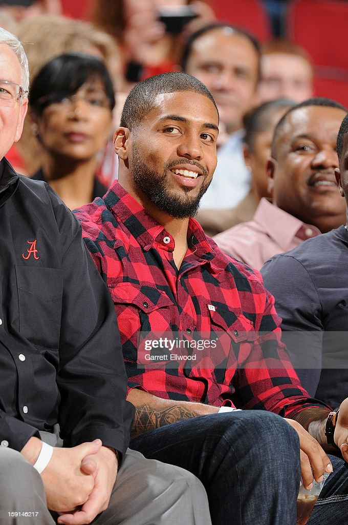 NFL player Arian Foster watches from court side in a game between the Los Angeles Lakers and the Houston Rockets on January 8, 2013 at the Toyota Center in Houston, Texas.