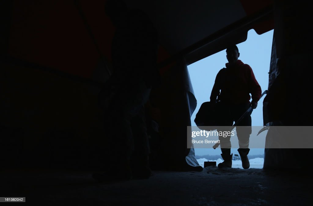A player arrives to the changing tent prior to the start of the 2013 USA Hockey Pond Hockey National Championships on February 10, 2013 in Eagle River, Wisconsin. The three day tournament features 2,400 participants from 30 states playing a round robin tournament on 28 rinks laid out on Dollar Lake.