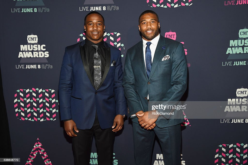NFL player Avery Williamson and NFL player Wesley Woodyard attends the 2016 CMT Music awards at the Bridgestone Arena on June 8, 2016 in Nashville, Tennessee.