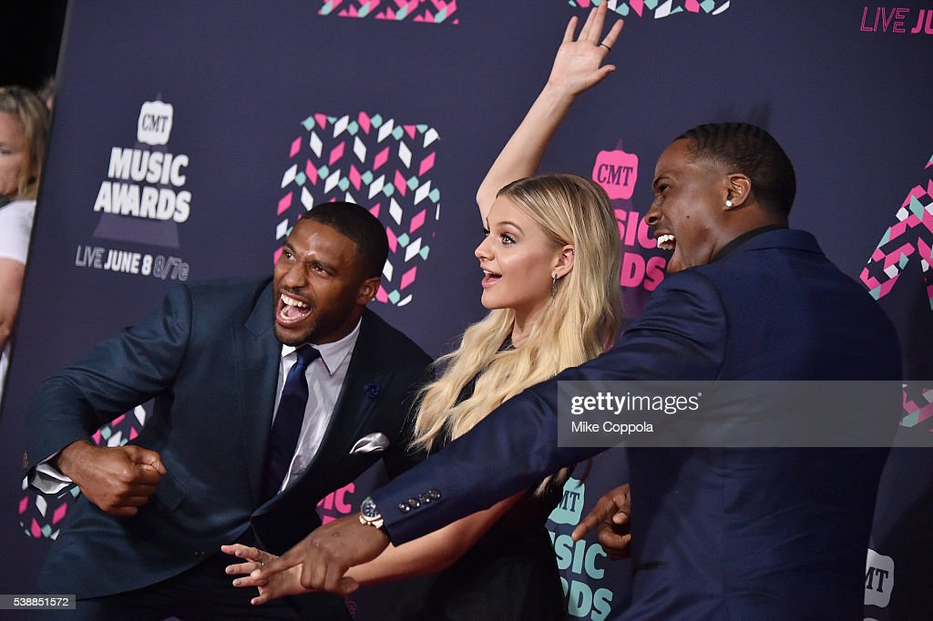 NFL player Avery Williamson, singer-songwriterKelsea Ballerini and NFL player Wesley Woodyard attends the 2016 CMT Music awards at the Bridgestone Arena on June 8, 2016 in Nashville, Tennessee.