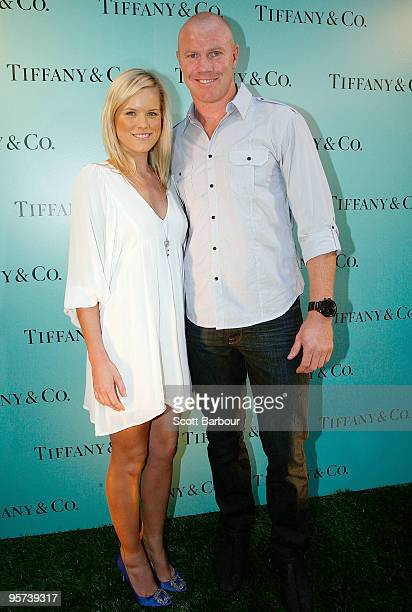 AFL player Barry Hall and partner Sophie Raadschelders pose for photographers as they arrive to see Maria Sharapova showcase the Paloma Picasso...